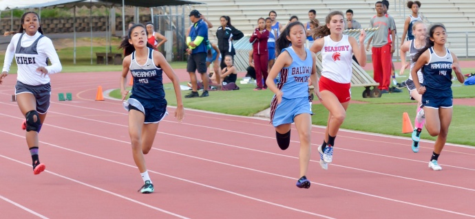 Baldwin's Mindy Kimura and Kamehameha Maui's Ani Nitta battle in their heat of the girls junior varsity 100-meter dash Friday at Yamamoto Track & Field Facility.  Kimura nipped Nitta, 13.35 seconds to 13.36. Also pictured are Kihei Charter's Camryn Henry (14.09),  Seabury Hall's Jenna Carvalho (13.83) and Kamehameha Maui's Brylee Carillo (14.35).  Photo by Rodney S. Yap.