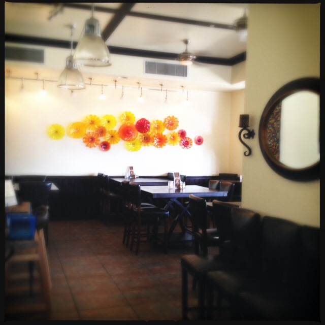 The restaurant's dining area features a striking art piece from local glass artist, Rick Strini. Photo by Vanessa Wolf