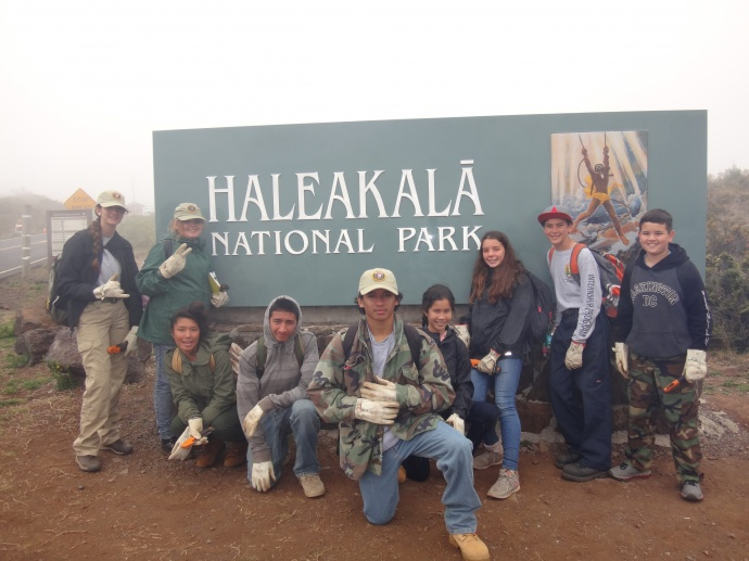 Interns at park entrance sign. Photo courtesy Haleakalā National Park.