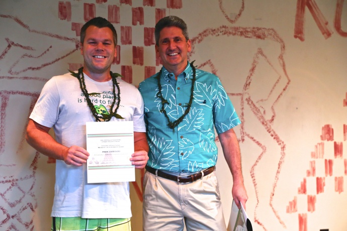 UH President David Lassner and award recipient Pierre Parranto, Student President of the Student Ohana for Sustainability at UHMC.  Photo credit: Ryan Kramer.