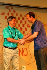 UH President David Lassner presents award to Executive Director Alex de Roode of the Sustainable Living Institute of Maui. Photo credit: Photo by Ryan Kramer.