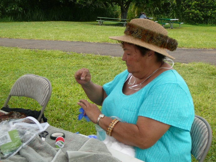 Patricia Gomez makes a feather flower. Photo credit: Haleakalā National Park.