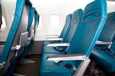 Hawaiian Airlines announced completion of a comprehensive retrofit on the first of its 18 Boeing 717 aircraft, featuring an island-inspired interior cabin redesign and new lightweight Main Cabin seating. (PRNewsFoto/Hawaiian Airlines)
