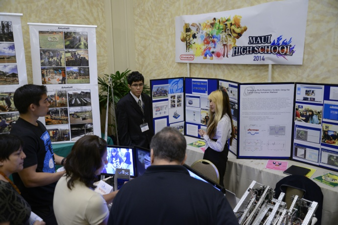 Preston Rodrigues Masago and Anna Maiwa of Maui High School gave their Project Impact Assessment presentation to the judges during the 2014 Hawaii STEM Conference.