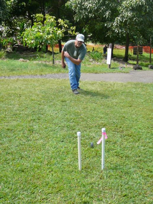 A visitor plays `ulu maika (lawn bowling). Photo credit: Haleakalā National Park.