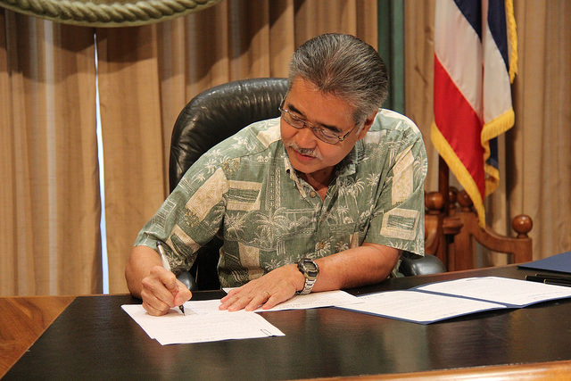 Governor Ige signs a bill into law that designates the ōpe'ape'a or Hawaiian Hoary Bat as the official state land mammal in Hawai'i.  Photo courtesy Office of the Governor, State of Hawai'i.