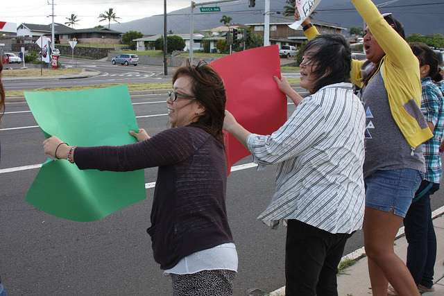UHMC Get Your Reg On!!! campaign sign waving event along Kaʻahumanu fronting the Kahului campus. Photo courtesy UHMC.