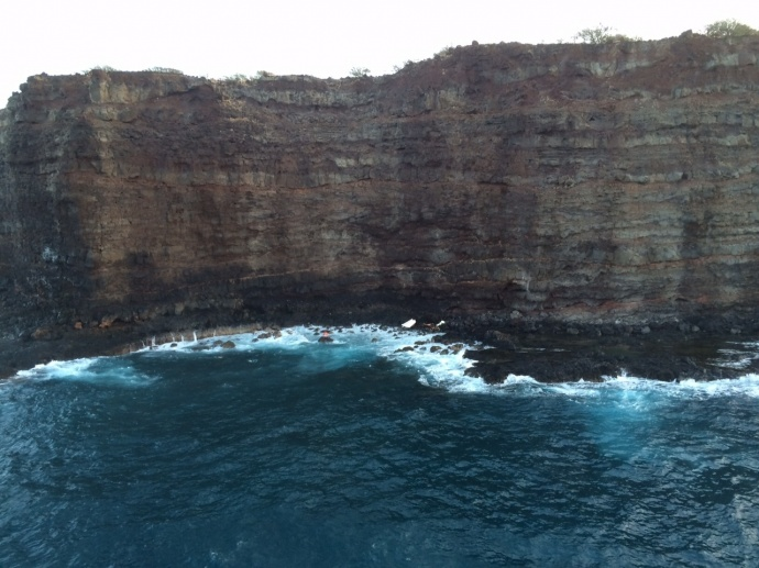 This image is of a debris field located off Lānaʻi, Hawaiʻi, April 24, 2015. The Coast Guard rescued one man and continues searching for another after 34-foot fishing vessel Munchkin ran aground on rocks approximately one mile west of Lanai. (U.S. Coast Guard courtesy photo)