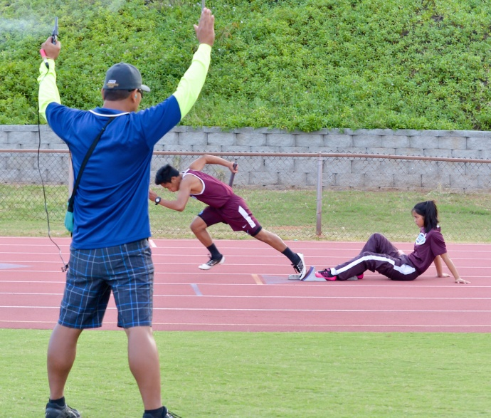 Baldwin's Joel Aquino reacts to the gun of starter Beldon Bautista Thursday during the first leg of the boys 400-meter relay. Photo by Rodney S. Yap.