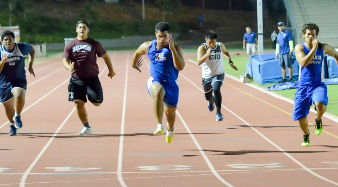 Maui High's Moana Vainikolu wins the weightman's  40-yard dash. Photo by Rodney S. Yap.