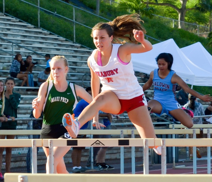 Seabury Hall's Makena Dougherty won both girls hurdle races Friday and was the meet's individual high scorer with 30.5 points. Photo by Rodney S. Yap.