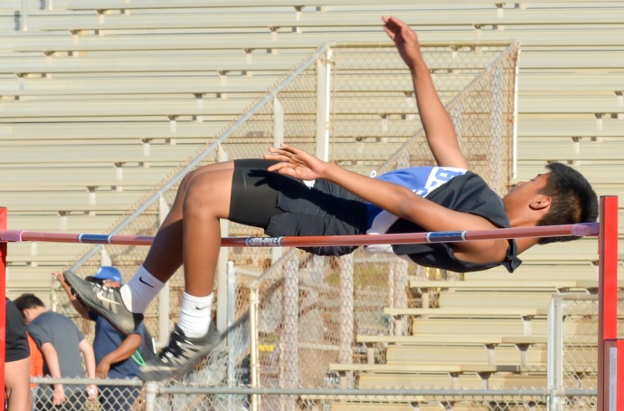 Maui High's Clarence Daguio won the boys high jump by clearing 5 feet, 7 inches. Photo by Rodney S. Yap.