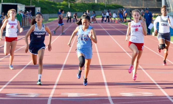 Baldwin's Mindy Kimura wins the girls 100 meters ahead of Seabury Hall's Claire Borthwick and Kamehameha Maui's Ani Nitta. Photo by Rodney S. Yap.