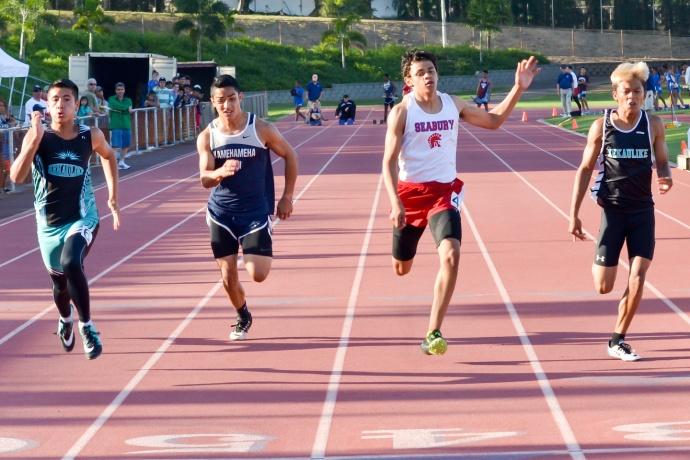 King Kekaulike's Shane Ribucan (left) wins the boys 100 meters ahead of teammate Brennan Taberna (right), Seabury Hall's Isaiah Payne and Kamehameha Maui's Damon Martin.  Photo by Rodney S. Yap.