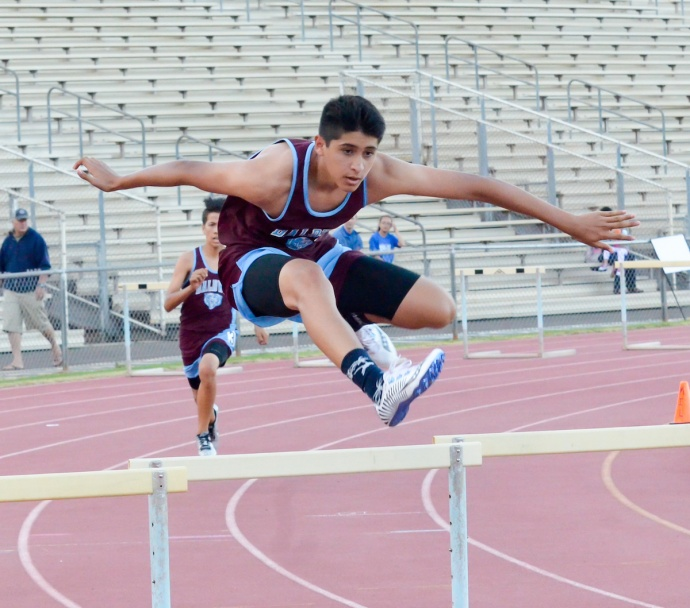 Baldwin's Kyle Felix wins the boys 300-meter hurdles.  Photo by Rodney S. Yap.