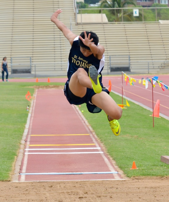 St. Anthony's Kei Sakai won the boys long jump Saturday with a leap of 19 feet, 3.75 inches. Photo by Rodney S. Yap.