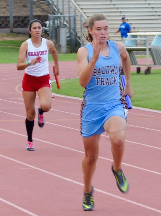 Baldwin's Kaitlin Smith anchors the Bears' winning 4 x 100 relay team. Photo by Rodney S. Yap.