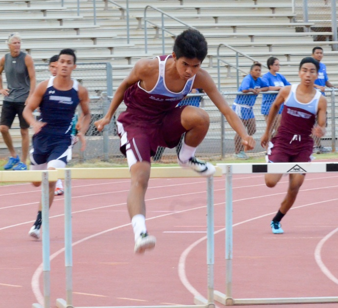 Baldwin's Kiernan Mateo, the state's best 300 hurdler, leads at the halfway point Saturday. Photo by Rodney S. Yap.