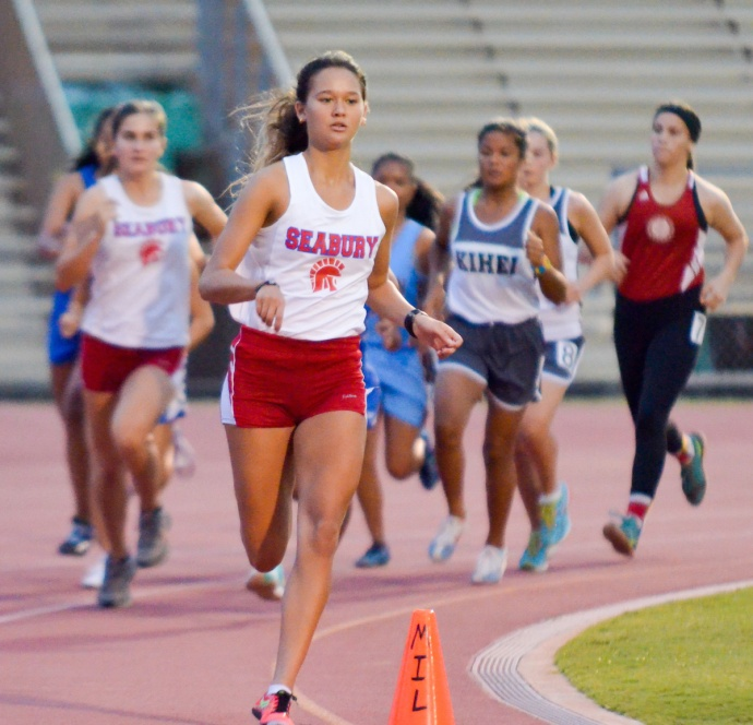 Seabury Hall's Ava Shipman leads the pack  in the first lap of the girls 3,000-meter run Saturday. Photo by Rodney S. Yap.