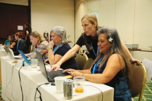 Conference Instructor Marybeth Baldwin assists teachers Lila Parong (Prince Jonah Kalanianoaole Elementary & Intermediate School) with Tourbuilder, a software program during one of the teacher professional development workshops. Courtesy photo.