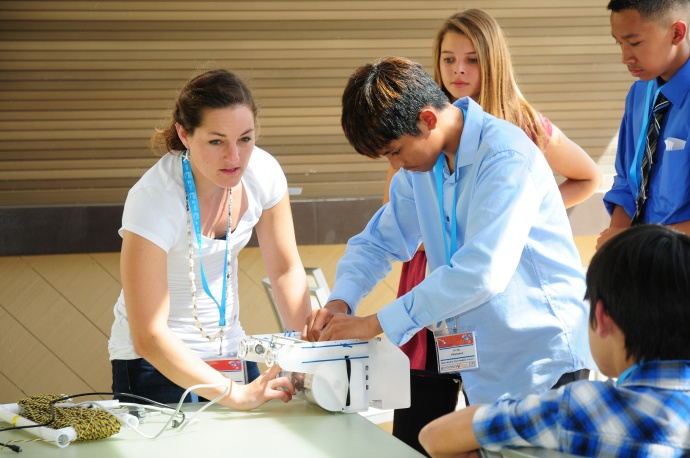Conference keynote speaker Erika Bergman of National Geographic assists Jacob Villanueva (Maui Waena Intermediate School) with prepping an underwater ROV. This hands-on breakout session gave students an immersive experience in real world applications of marine technology and ocean exploration. Courtesy photo.