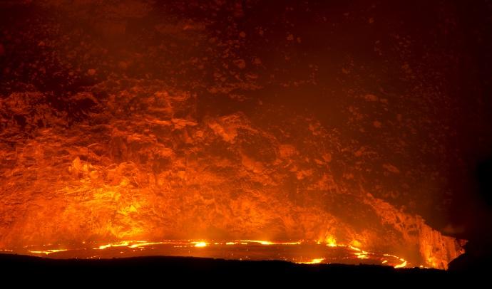 The rising lava lake within Halema'uma'u Crater at the summit of Kīlauea volcano draws thousands of additional visitors to Hawai'i Volcanoes National Park. NPS Photo/Mark Wasser 