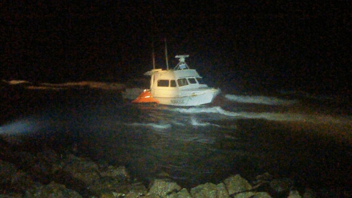 """Mokulele"" vessel aground at Koki Beach in East Maui. Photo courtesy MFD, April 10, 2015."