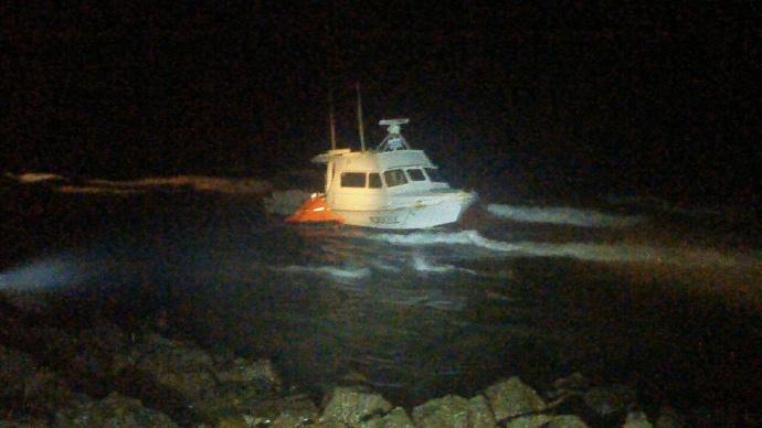 """Mokulele"" vessel aground at Koki Beach in East Maui. Photo courtesy MFD, April 10, 2015."
