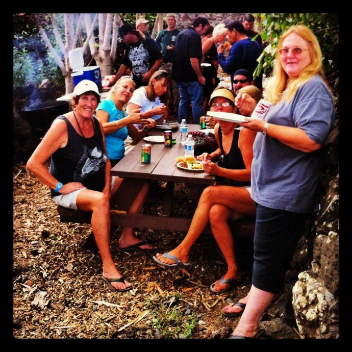 Margo pictured (front left in black tank top) with other volunteers while she was volunteering at the ʻĀhihi Kīnaʻu Natural Area Reserve as a volunteer interpretive guide. Courtesy photo.