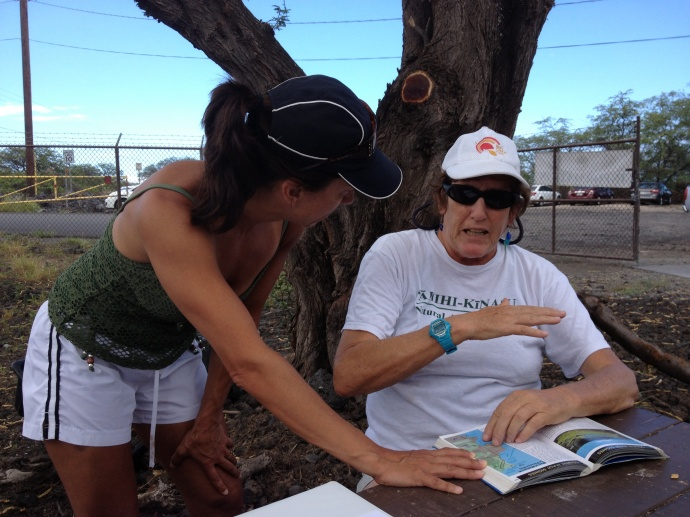 Margo pictured (right) helping a visitor while she was volunteering at the ʻĀhihi Kīnaʻu Natural Area Reserve as a volunteer interpretive guide. Courtesy photos.