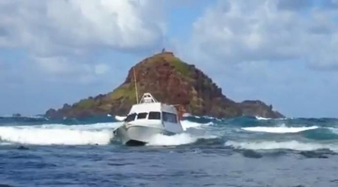 Grounded fishing boat in Hāna, Maui at Koki.  Image by Mavis Oliveira-Medeiros.