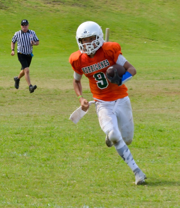 Wailuku's quarterback enjoys some running room, going wide against Lahaina Saturday. Photo by Rodney S. Yap.