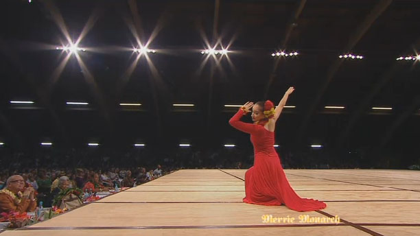 "Jasmine Kaleihiwa Dunlap of Hula Hālau 'O Kamuela, under the direction of Kumu Kau'ionalani Kamana'o and Kunewa Mook dances to ""Hōpoe."" Screenshot from televised broadcast credit: KFVE/Merrie Monarch Hula Festival."