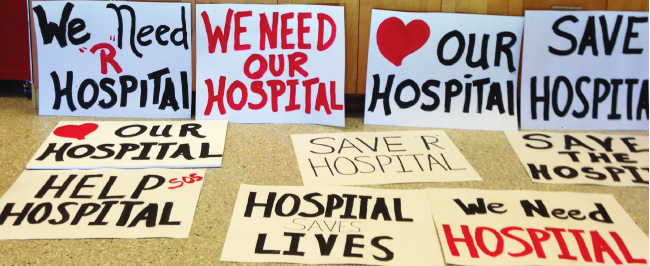 Signs being prepped for Hospital rally.