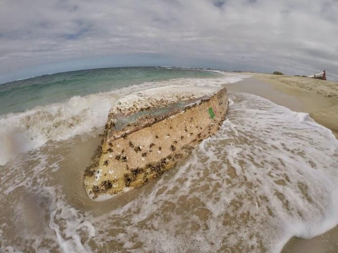 Skiff on Kahuku golf course beach. Photo courtesy Lance Redding.