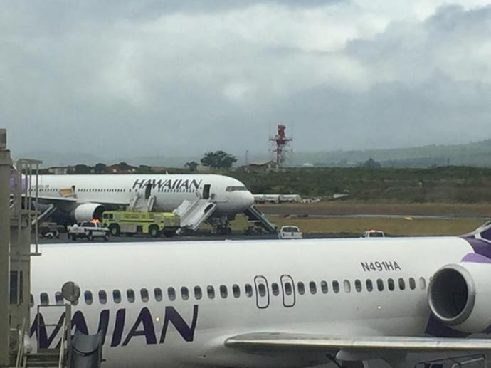 Hawaiian Airlines plane makes emergency landing at Kahului Airport. Photo credit: Jen Tempchin.