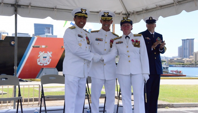 Rear Adm. Vincent B. Atkins (left) assumes command from Rear Adm. Cari B. Thomas (right) as commander of the Fourteenth Coast Guard District during a change of command ceremony at Base Honolulu, May 28, 2015. Vice Adm. Charles W. Ray, commander, Pacific Area, presided over the ceremony. The change of command ceremony is a time-honored tradition transferring total responsibility, authority and accountability from one individual to another. (U.S. Coast Guard photo by Petty Officer 3rd Class Melissa E. McKenzie)
