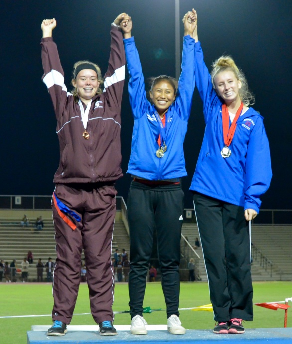 Seabury Hall's Elle Bega (middle) won the gold medal in the  girls triple jump. Teammate Christy Fell was second Baldwin's Kaitlin Smith (left) finished third. Photo by Rodney S. Yap.