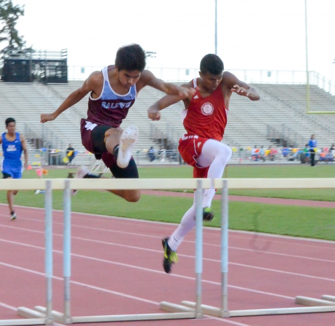 Baldwin's Kiernan Mateo beats Lahainaluna's Emerson Liburd in the 300 hurdles. Liburd, however, beat Mateo in the 110 highs, breaking the meet record of 14.64 with a winning time of 14.60. Photo by Rodney S. Yap.