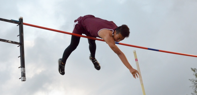 Baldwin's Kainoa Tom won the boys pole vault at 15-3, just missing this attempt at tying the MIL meet record of 15-9. Photo by Rodney S. Yap.