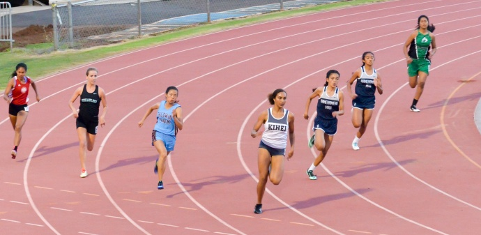 Kihei Charter's Maya Reynolds leads her heat of the girls 200-meter dash at Friday's MIL track and field trials. Photo by Rodney S. Yap.