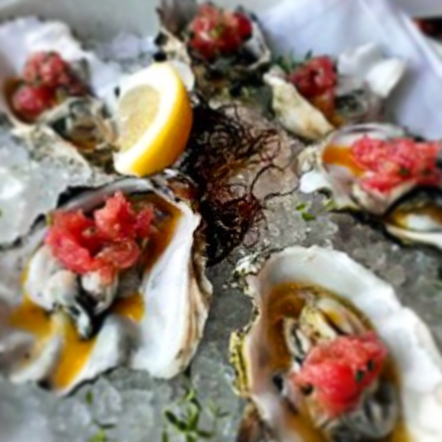 The oysters are topped with ahi, lilikoi and It, Which Will Not Be Named. Photo by Vanessa Wolf