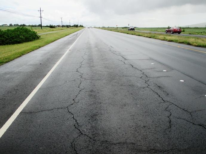 The cracked Mokulele roadway before construction began. Photo courtesy Maui County.