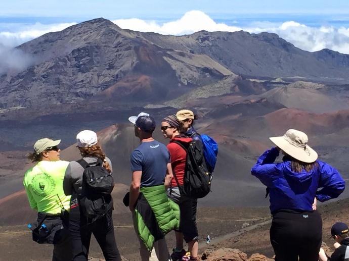 Kevin Kavula with crater visitors. Photo courtesy Haleakalā National Park.