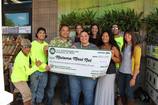 (Left to right) MMN Road Crew Stacy Panlasigui and Josh Bajadali; MMN Executive Director John P. de Jesus; Whole Foods Marketing Team Leader Elyse Ditzel; Whole Foods Associate Store Team Leader Christine Georgedes; MMN Community Relations Manager Jen Cox; MMN Volunteer Coordinator Lauren Kennedy; MMN Road Crew Cesar Jardon; MMN Operations Manager Gabrielle Schuerger. Photo courtesy of Whole Foods Market Kahului.