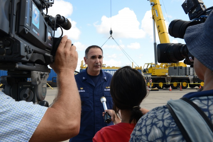 Capt. Shannon Gilreath, Coast Guard Sector Honolulu commanding officer, conducts interviews with local media during the Hawaii Alternate Port Concept Full Scale Exercise at Joint Base Pearl Harbor-Hickam, June 5, 2015. The purpose of this exercise is to prepare the State, Navy, Coast Guard and industry response partners for their roles during a major catastrophic event that closes the Port of Honolulu and requires the activation of the Alternate Port in Pearl Harbor. (U.S. Coast Guard photo by Petty Officer 2nd Class Tara Molle)