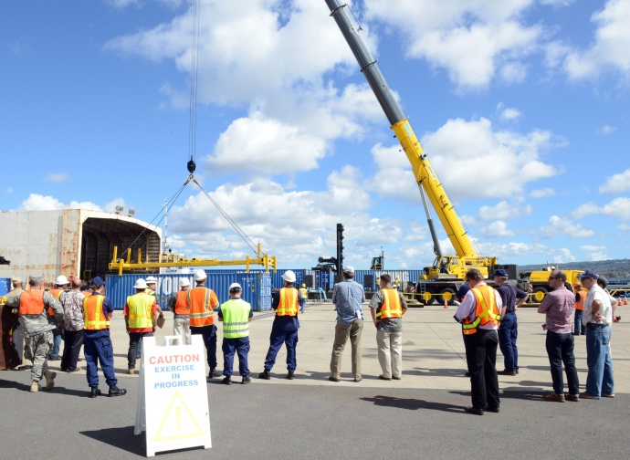 Personnel from the Coast Guard, Navy, state of Hawaii and key industries partners observe crane operations during the Hawaii Alternate Port Concept Full Scale Exercise at Joint Base Pearl Harbor-Hickam, June 5, 2015. The purpose of this exercise is to prepare the state, Navy, Coast Guard and industry response partners for their roles during a major catastrophic event that closes the Port of Honolulu and requires the activation of the Alternate Port in Pearl Harbor. (U.S. Coast Guard photo by Petty Officer 2nd Class Tara Molle)