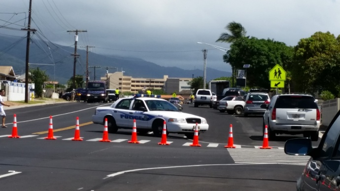 Maui police conduct investigation into moped fatality in Kahului. Photo by Wendy Osher.