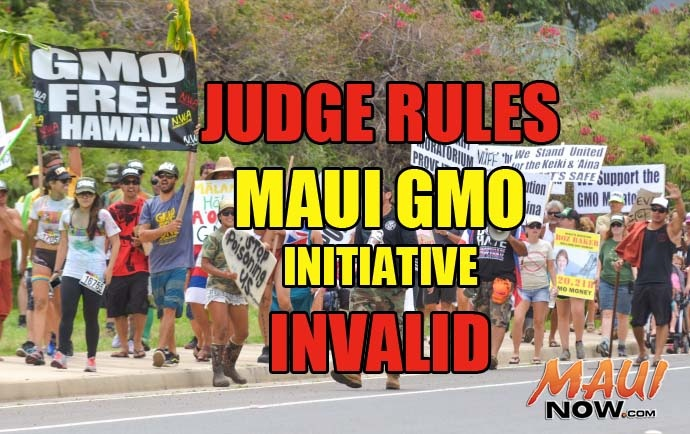 Maui Now Graphic. Background image: More than 1,000 marchers participated in an Anti-GMO event on Sunday, March 30, 2014. File photo by Rodney S. Yap.