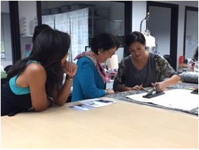 Senator Hirono cuts a pattern for a shirt with designer Allison Izu at High Technology Development Corporation/Cut Collective. Courtesy photo.